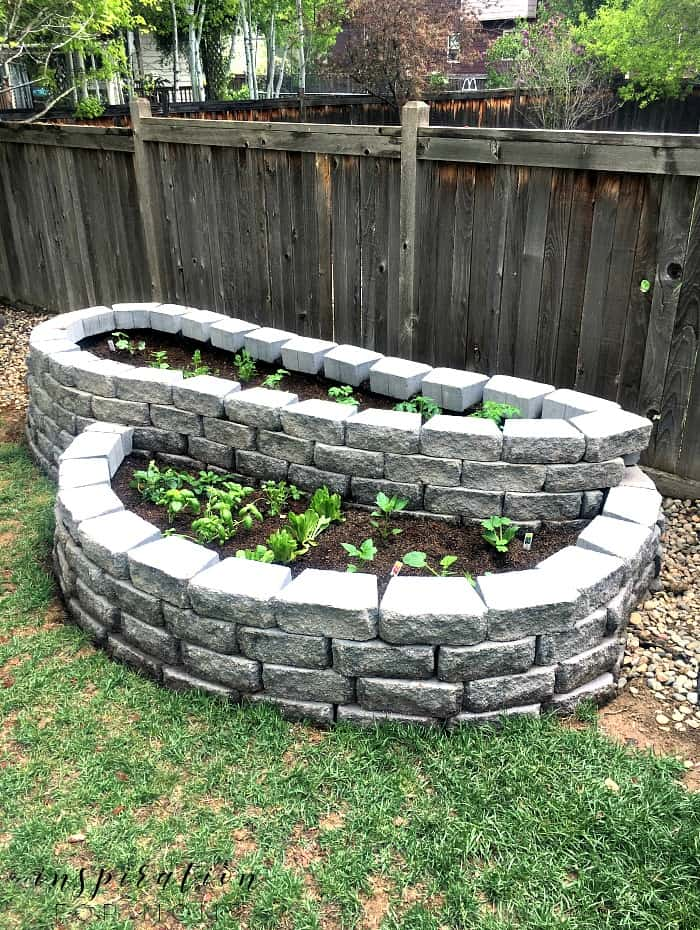 Raised outdoor garden with stone