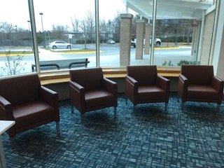 Comfortable reading chairs at the entrance of the library.