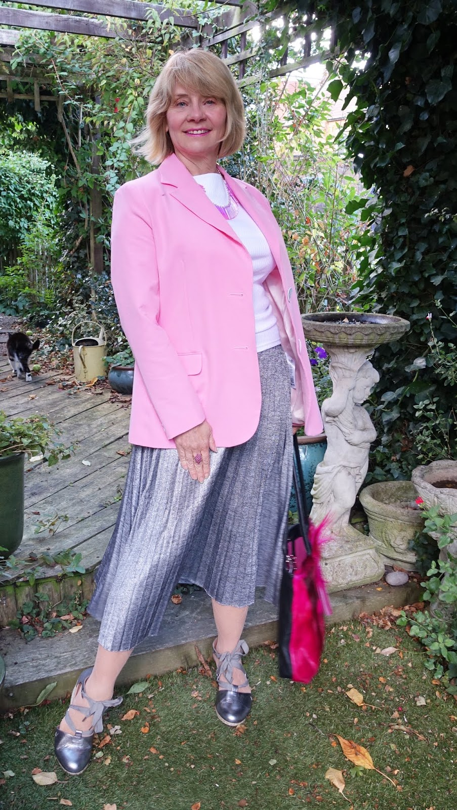 Is This Mutton blogger Gail Hanlon in Vionic Kaitlyn espadrilles, silver skirt and pink jacket