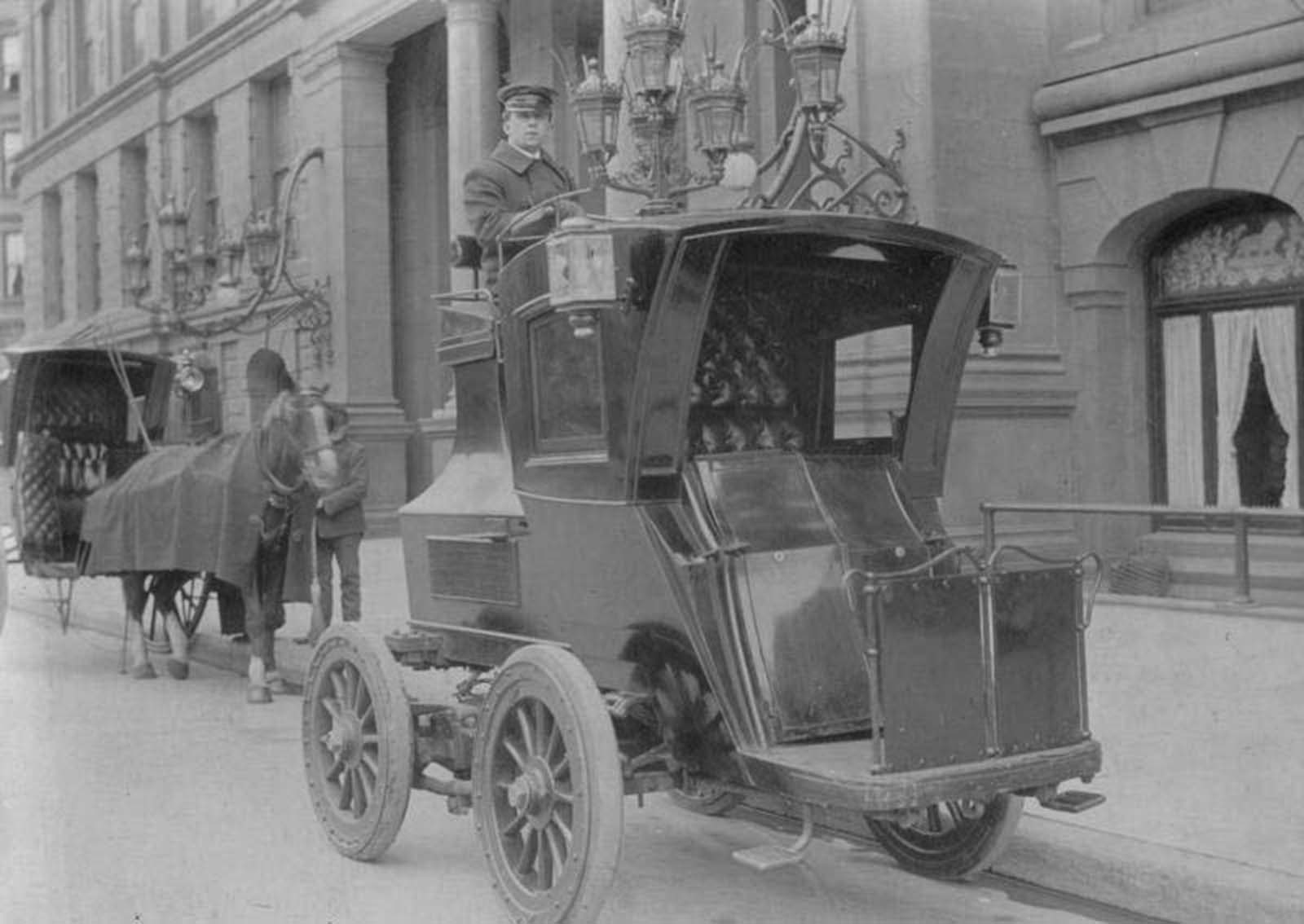 German electric car, 1904, with the chauffeur on top.