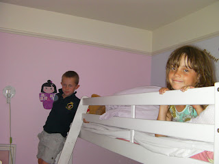 kids on bunk beds in pink room