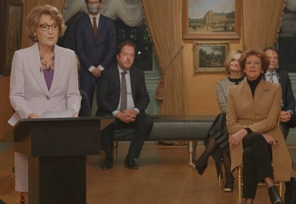 Princess Margriet is honorary president of the Dutch Red Cross. Princess wore a lilac blazer and skirt suit. She carries lilac satin clutch bag