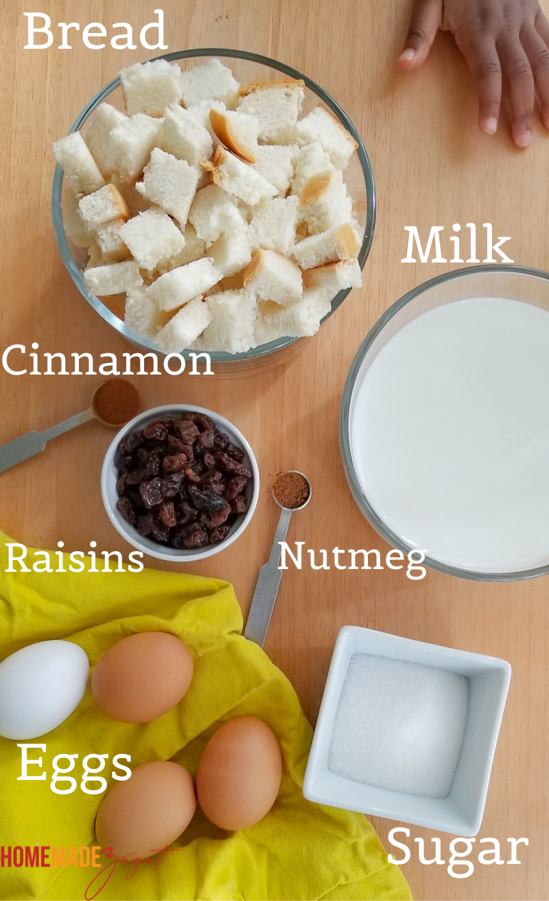 Ingredients for Jamaican bread pudding - raisins, bread, eggs, sugar, spices