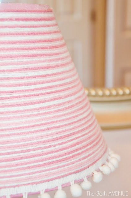 DIY lamp makeover using yarn. This home decor idea is great to turn your old lampshades into new and trendy home decor accents.