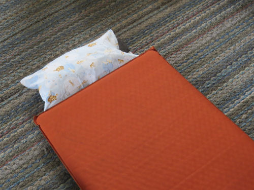 sleeping mat with attached pillow
