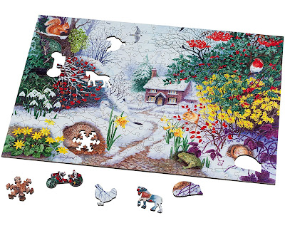 Puzzle on white background with custom shaped pieces laid beside: Snowflake, Tractor, Chicken, Horse and a Hedgehog.
