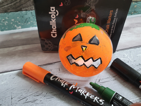 Creating Pumpkin baubles to hang up outside for Halloween Craft