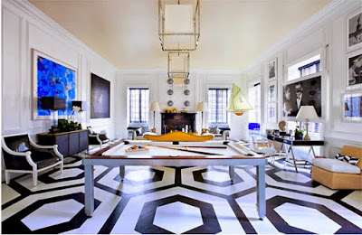 wood floor painted in balck and white honeycomb pattern