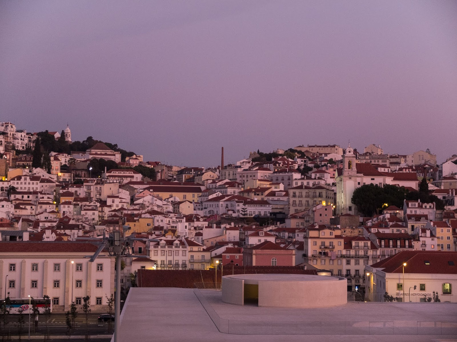 Buildings of Lisbon captured from the port at sunrise.