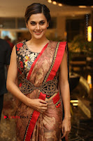 Tapsee Pannu Latest Stills in Red Silk Saree at Anando hma Pre Release Event .COM 0031.JPG