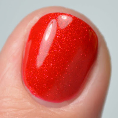 red shimmer nail polish close up swatch