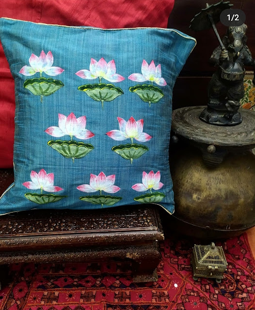 Pretty handprinted lotuses on teal cushion covers