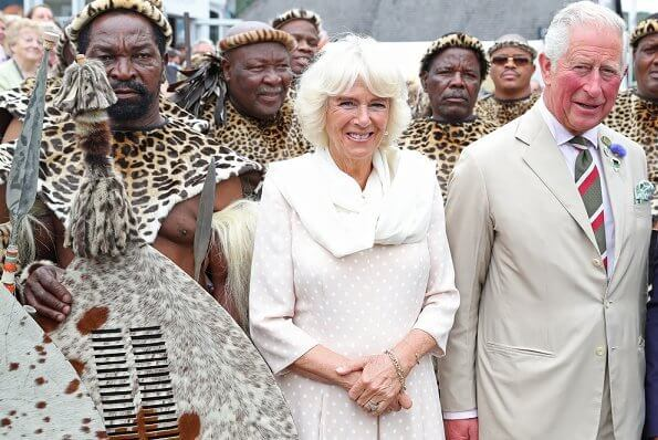 Prince Charles and Duchess of Cornwall met with King Goodwill and Queen Pumi of the Zulus. Burberry trench coat