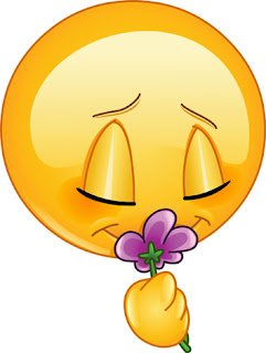 Clipart Image of a Smiley Face Smelling a Flower