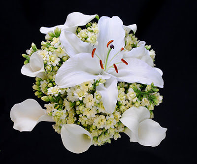 white calla lilies, white lilies, and kalanchoe wedding bouquet