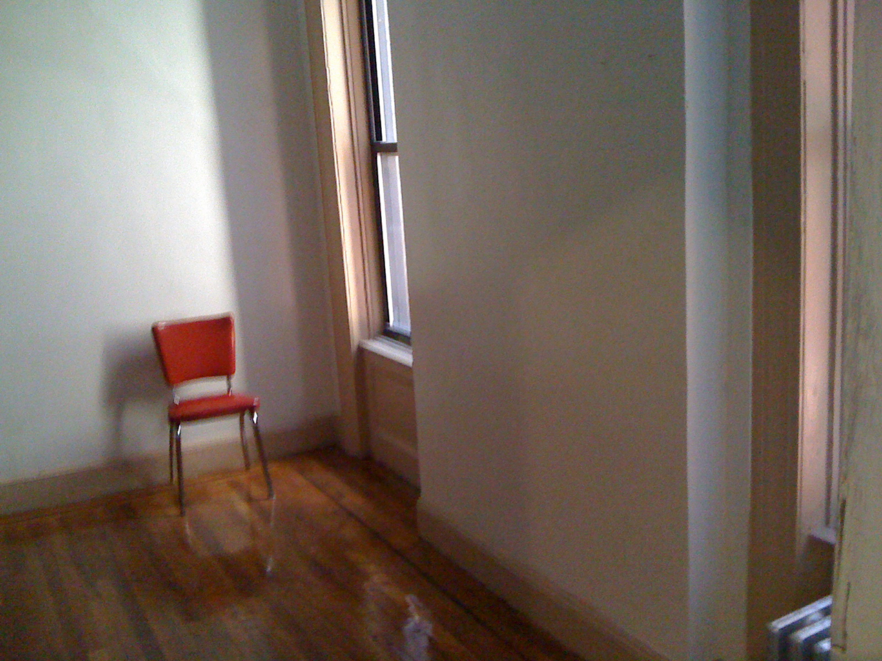 the room  with red Chair in Harlem