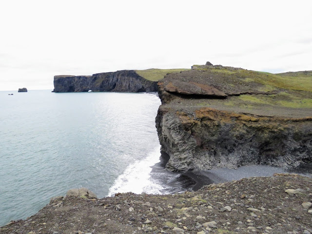 Sea cliffs near Dyrhólaey Peninsula are an ideal terminus to a self-drive day trip along the South Coast of Iceland