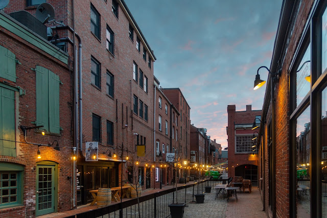 Portland, Maine USA April 2021 photo by Corey Templeton. The quiet of Wharf Street's bricks and cobblestones in the early morning.