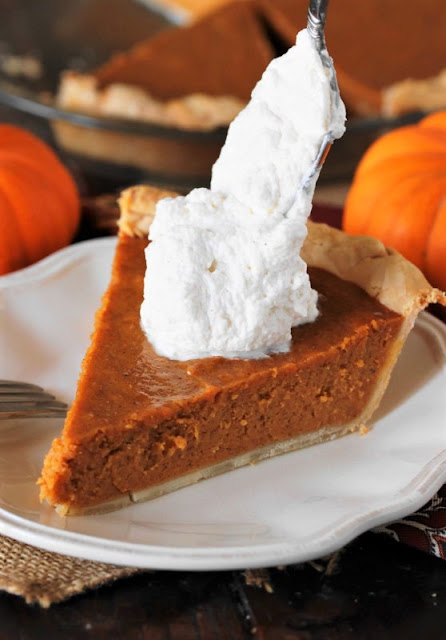 Topping Pumpkin Pie With a Dollop of Bourbon Whipped Cream Image