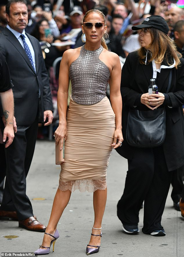 Stunning! Jennifer Lopez steps out in a crocodile print halterneck top and beige pencil skirt