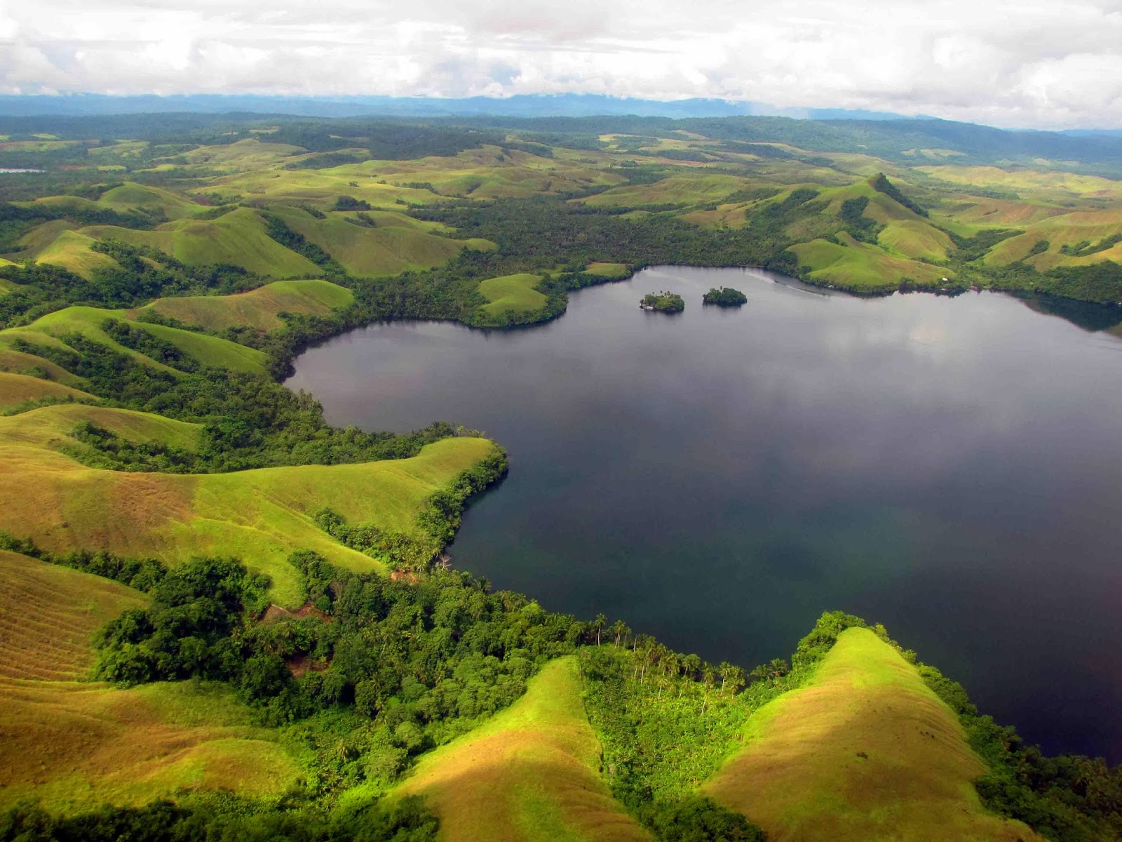 traveling ke danau sentani yang menawan internet marketing dan