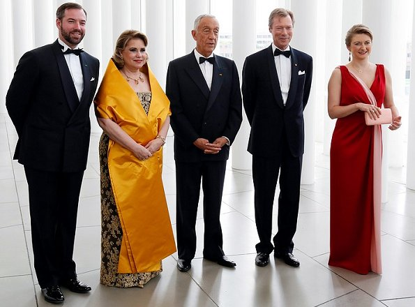 Princess Stephanie wore a red dress by French fashion house Paule Ka. Duchess Maria Teresa wore a dress by Belgian fashion designer Yves Dooms