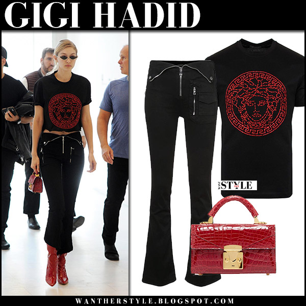 Gigi Hadid in black printed tee, black zip pants with red bag at Milan Fashion Week september 22 2017 street fashion