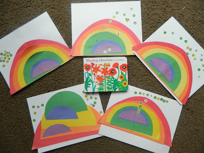 St Patrick's day for preschoolers making rainbows with paper and stickers and a book called 'Planting A Rainbow'.