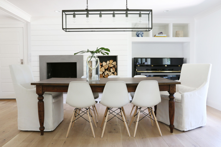 I Loved The Carved Legs Of This Classic Wood Dining Tables Especially Paired With Simple Modern White Chairs An Upright Piano Is Tucked In Wall