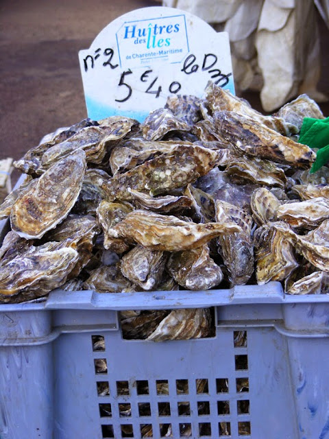 Oysters at a market, France. Photo by Loire Valley Time Travel.