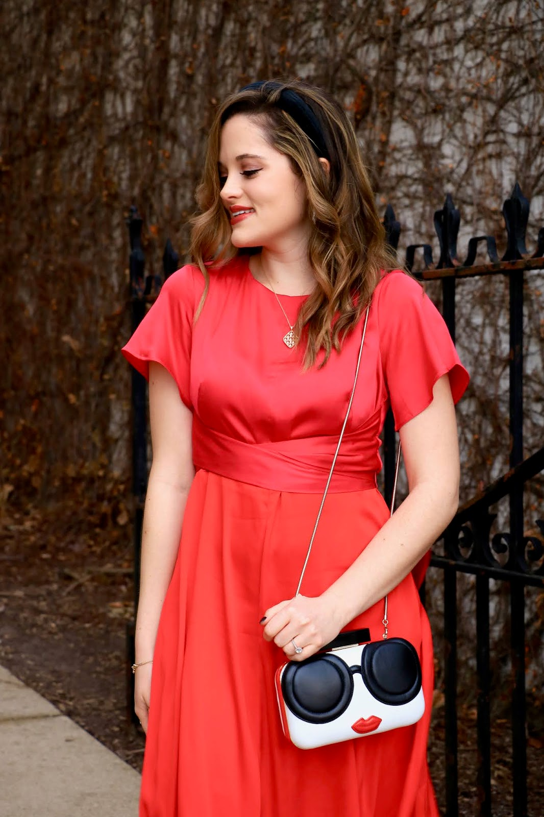 Nyc fashion blogger Kathleen Harper wearing a pink and red dress from Ann Taylor.
