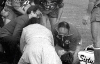A stricken Antognoni is attended by Genoa team doctor Pierluigi Gatto and others after his accident