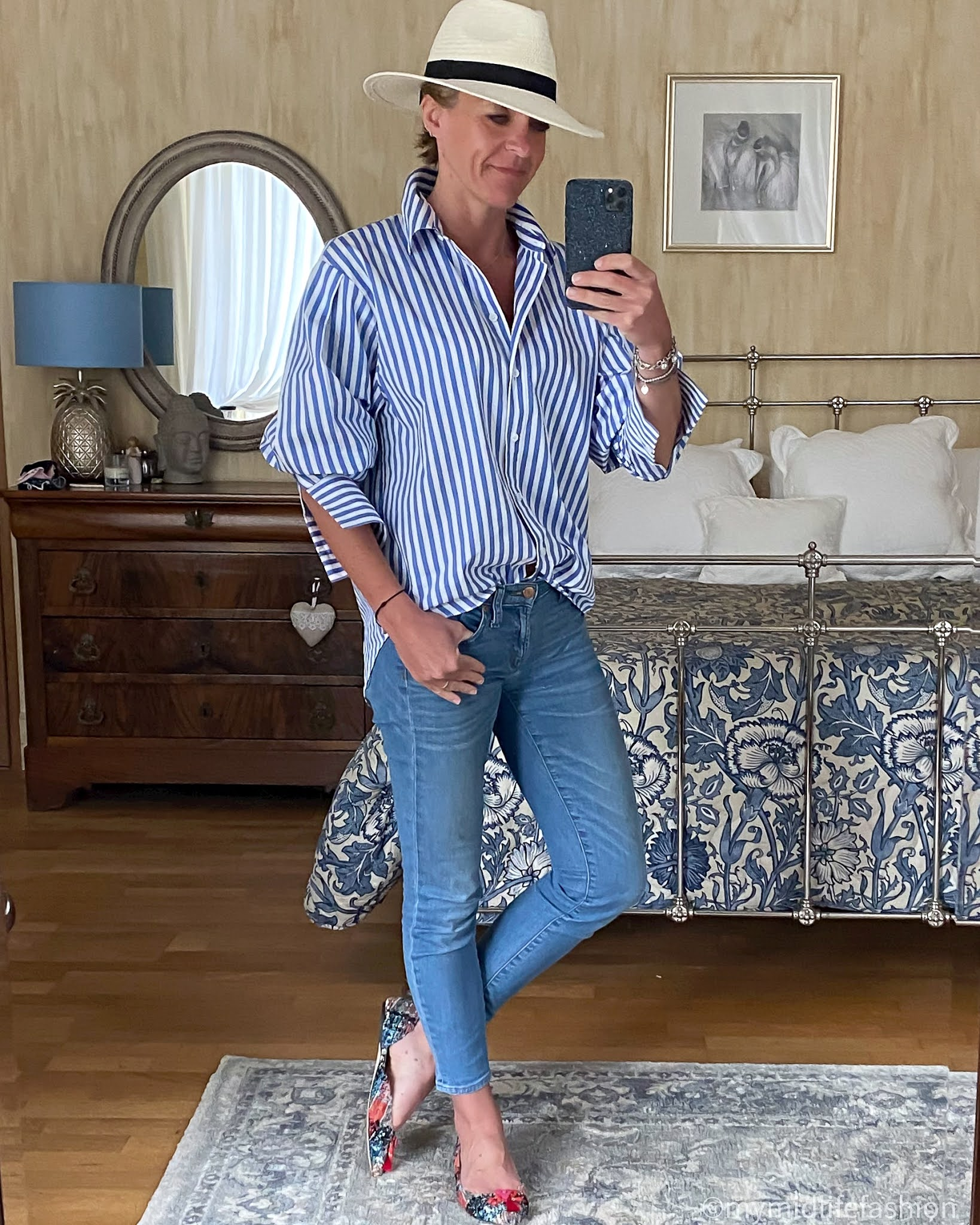 my midlife fashion, zara Panama hat, and other stories oversized stripe shirt, j crew 8 inch toothpick skinny jeans, j crew tweed pointed flat tassel shoes