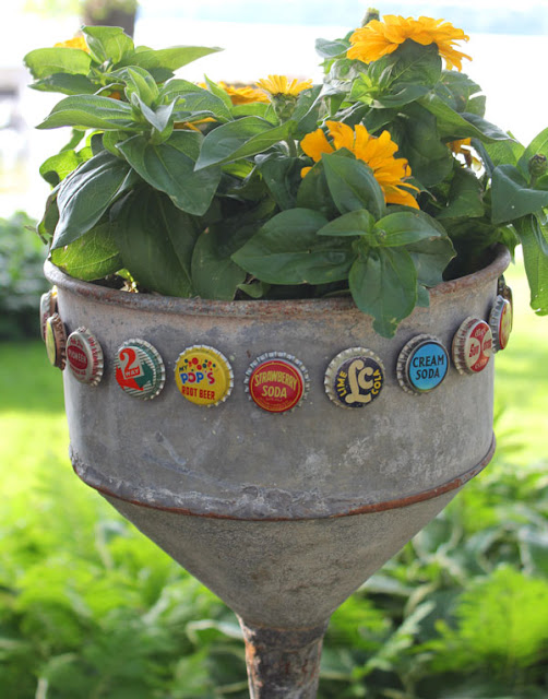 Making over an old farm garden funnel into a colorful planter from Itsy Bits And Pieces blog.