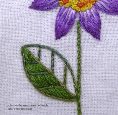 Embroider leaf in laid work with couched down veins (on purple flower)