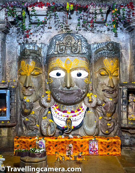 The sanctum of the temple contains an image of Shiva. The image depicts Shiva as having three heads and all of them are shown wearing jata-mukutas. Each of the three faces of Shiva idol has a third eye and the face on right bears a terrifying expression. Centre and the left faces of Shiva idol show peaceful expression.