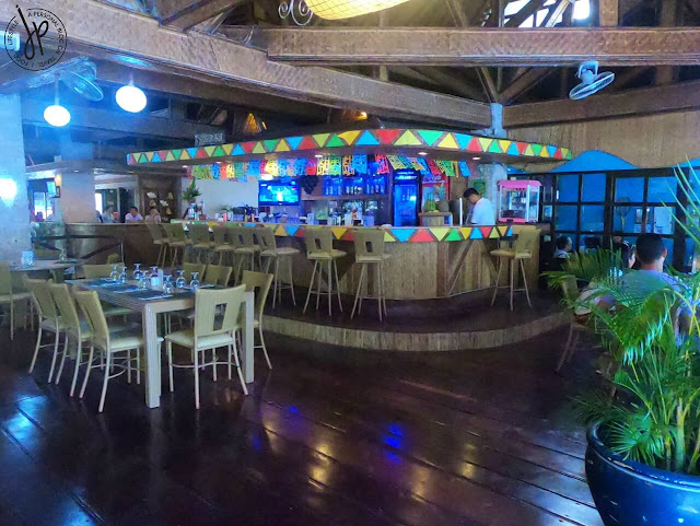restaurant, rattan chairs and tables, bar