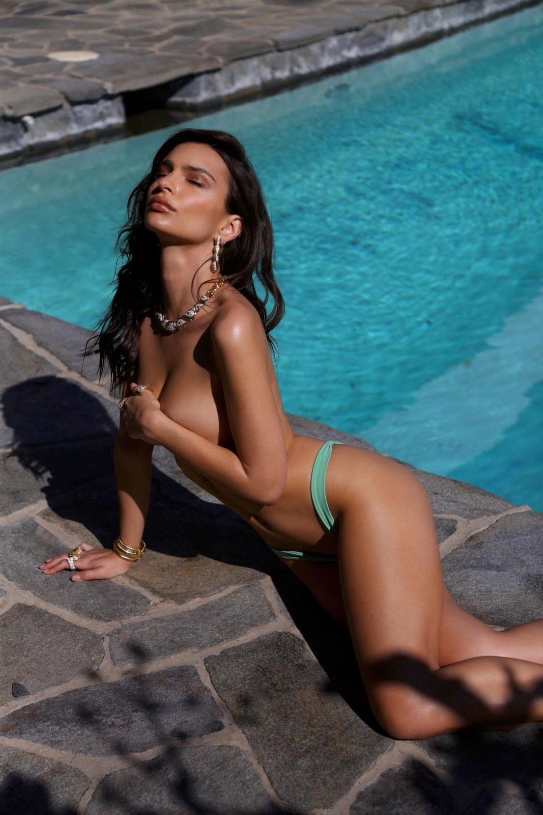 Emily Ratajkowski bares her bottom and goes topless in string of sizzling swimwear photos