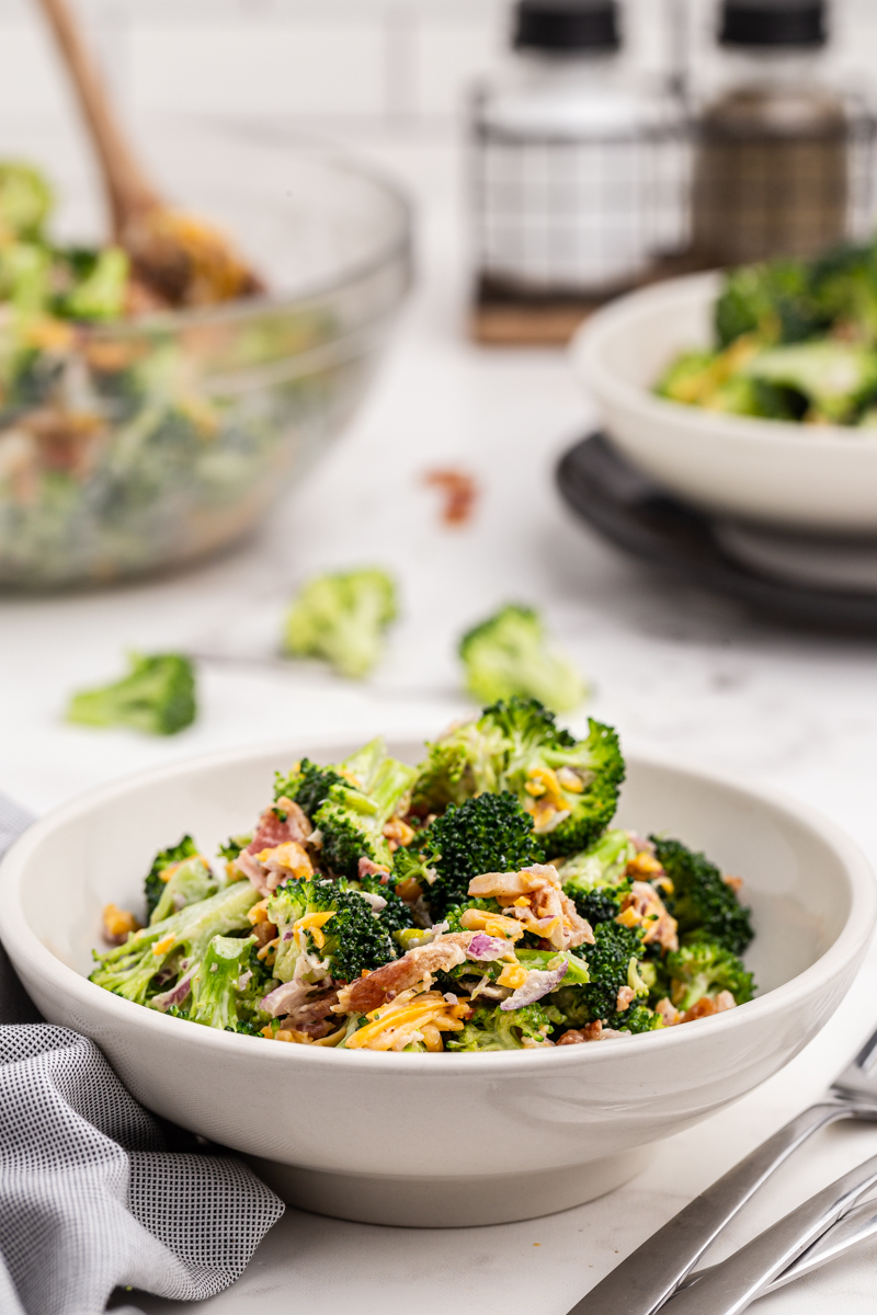 Photo of keto loaded broccoli salad in a white serving bowl.