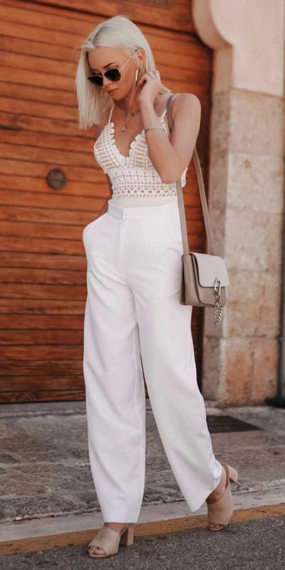 Looking forward to walking your workspace with style? Check out these 24 Stylish Summer Work Outfits for Women that are Office-friendly. Work Wear via higiggle.com | white boho top + pants | #summeroutfits #office #workoutfits #boho