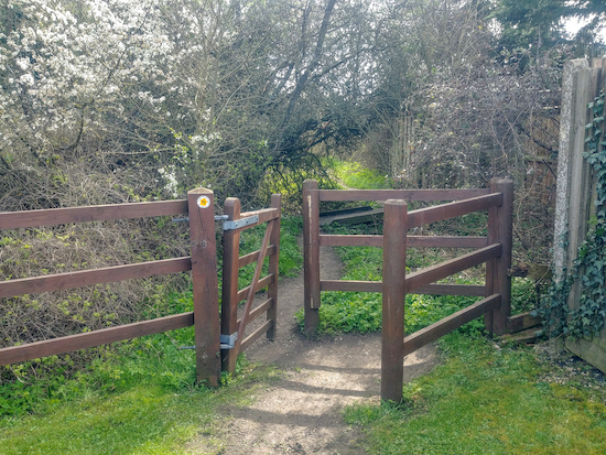 The gate to Weston footpath 15 just after The Rising Sun in Halls Green