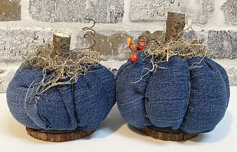 denim pumpkins with sticks and Spanish moss