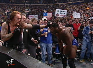 WWE / WWF No Mercy 2001 - The Undertaker ready to strike Booker T