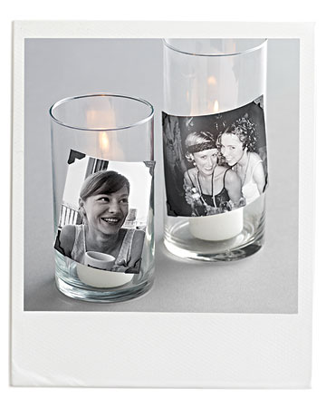 Candles in glass vases with personalized pictures on them are a fun and unique touch.