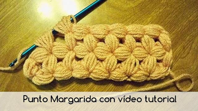 Beautiful pattern in crochet shawl with daisy flowers