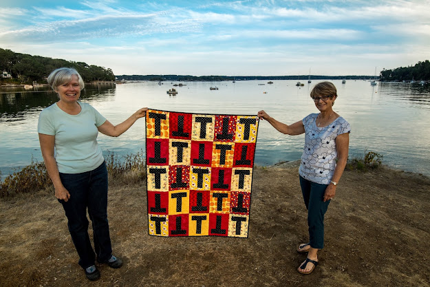 Louise delivering T-quilt 100 to Ann in Boothbay Harbor, Maine