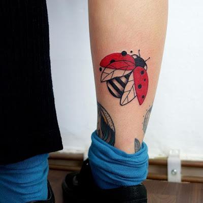 behind leg ladybug tattoo