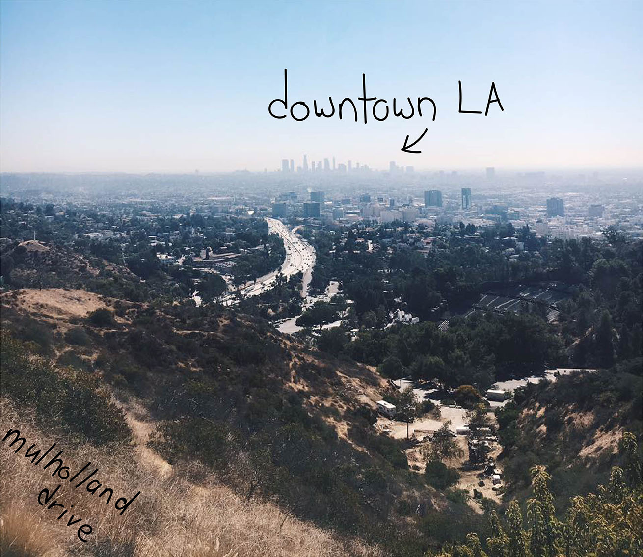 view of downtown LA and the 101 highway from Mulholland drive viewpoint