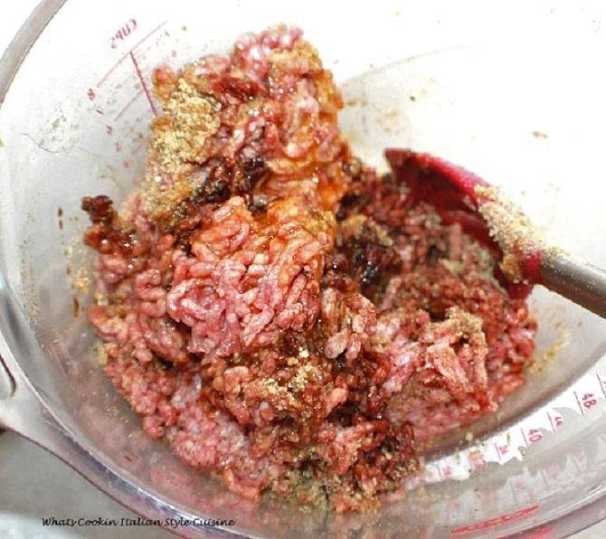 raw hamburger being mixed Italian style