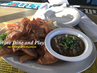 The black bean hummus appetizer special at Hooked Island Grill in Matlacha, Florida is served with fried pita chips